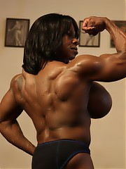 When female bodybuilder Yvette Bova poses naked in the gym, showing off her ripped, vascular biceps,...