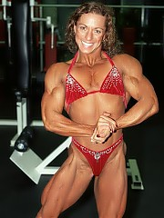 Autumn Raby poses with Nadia they are structurally similar and with similar muscle size and definiti...
