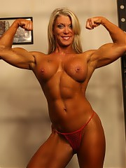 Female bodybuilder Ginger Martin is posing for you in the gym to show you how ripped her abs are, ho...