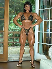 Nursel Gurler poses in a black bikini, all the muscle shots are show, with emphasis on her unreal up...